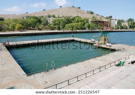 Beautiful cityscape - Diving Board into the water on the waterfront in Kerch, Crimea - stock photo