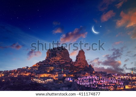 Beautiful cityscape - Uchisar castle in ancient town, Cappadocia, Turkey. Elements of this image furnished by NASA nasa.gov - stock photo