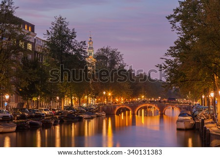 Beautiful cityscape with canal at dusk - stock photo