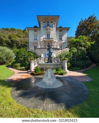beautiful classical mansion surrounded by a park, outdoors - stock photo