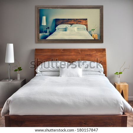 Beautiful Clean and Modern Bedroom with fun Canvas on the Wall that is a repetition or infinity concept - stock photo