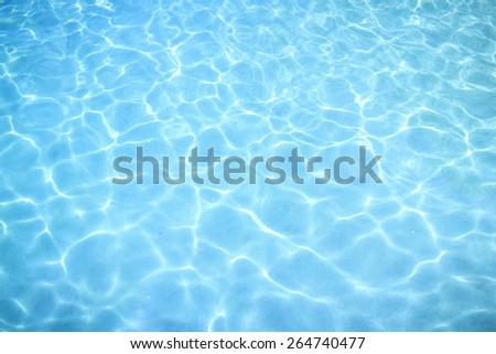 beautiful clear sea water reflecting in the sun - stock photo