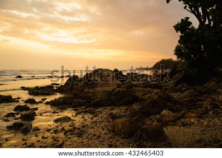 beautiful clouds and sky during sunset at the rocky beach in cloudy day during great holidays at a hotel in Thailand - stock photo