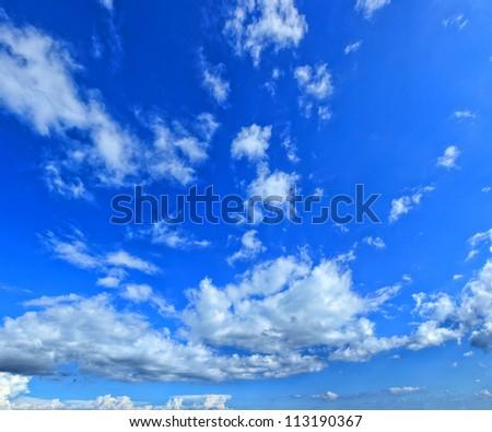 Beautiful cloudscape over blue sky - stock photo
