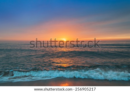 Beautiful cloudscape over the sea, sunrise shot. - stock photo