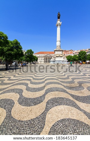 Beautiful cobbelstones on the Pedro IV square in Lisbon, Portugal - stock photo