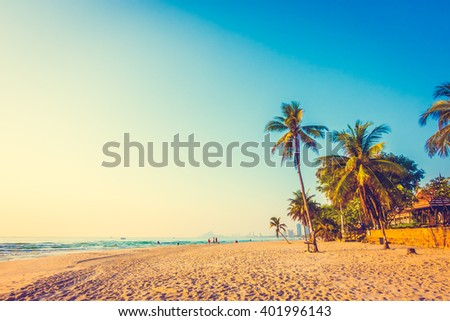 Beautiful coconut palm tree on the beach and sea - Vintage filter - stock photo