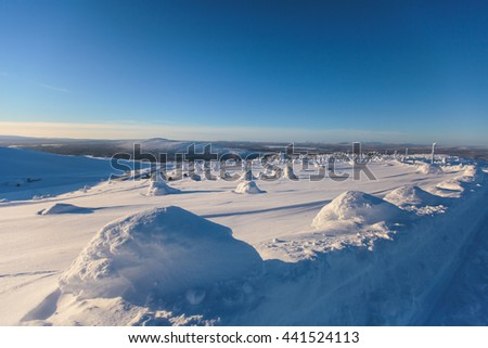 Beautiful cold mountain view of ski resort, sunny winter day with slope, piste and ski lift - stock photo