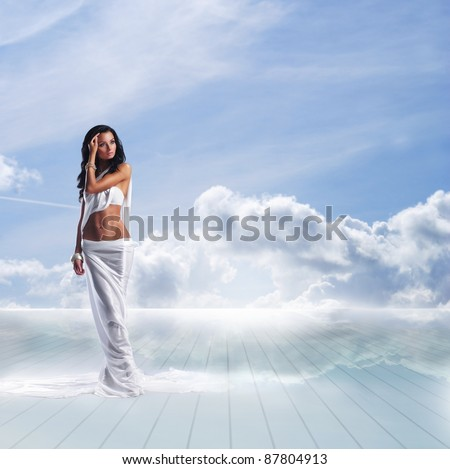 Beautiful collage with an ancient Greece styled woman walking in the clouds - stock photo