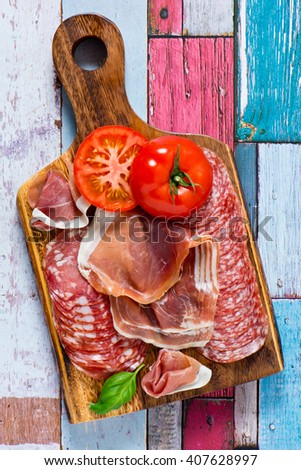 beautiful collection of sausages,ham,parma,salami on rusty wooden background. - stock photo