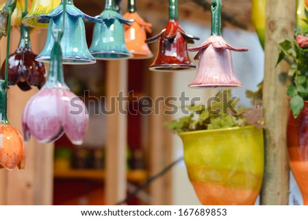 Beautiful colorful ceramic bells in row decoration on market - stock photo