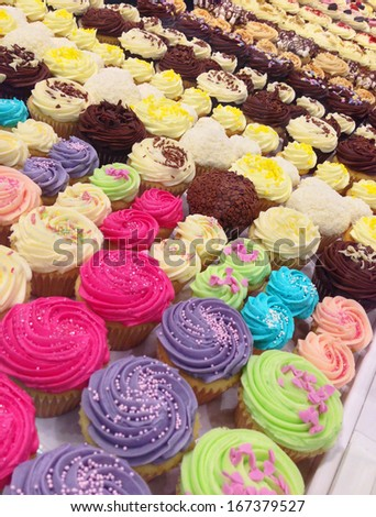 Beautiful colorful cupcakes - stock photo