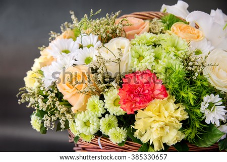 Beautiful colorful flowers in basket - stock photo