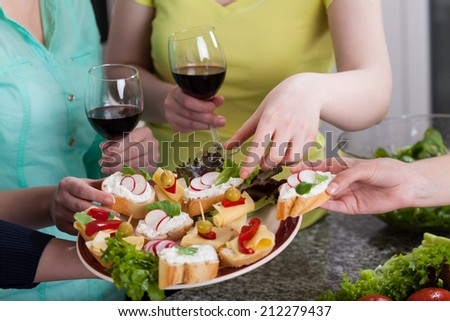 Beautiful colorful healthy sandwiches eating at home - stock photo