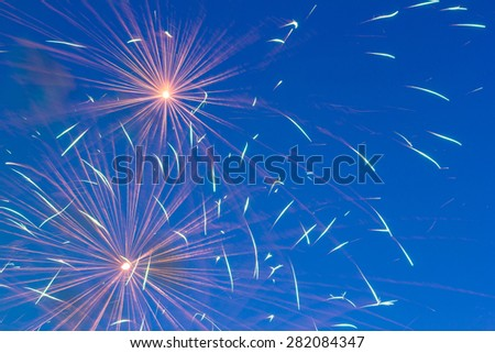 Beautiful colorful holiday fireworks in the evening sky - stock photo