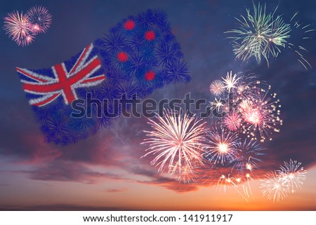 Beautiful colorful holiday fireworks with national flag of New Zealand, evening sky with majestic clouds - stock photo