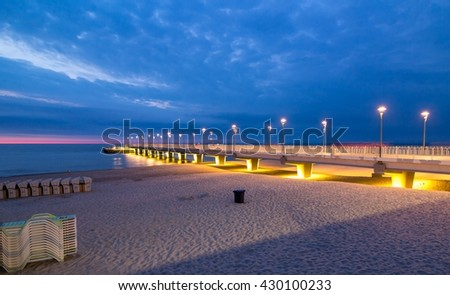 Beautiful colorful lights on the pier in the evening, Kolobrzeg, Poland - stock photo