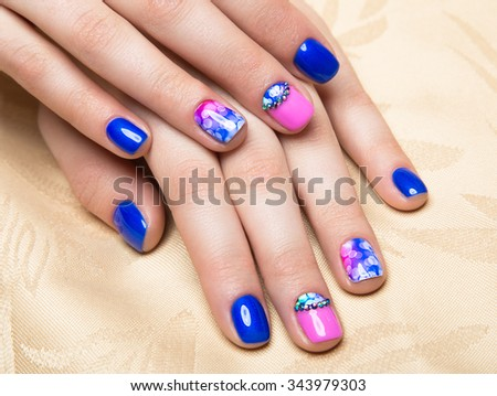 Beautiful colorful manicure with bubbles and crystals on female hand. Close-up.  - stock photo