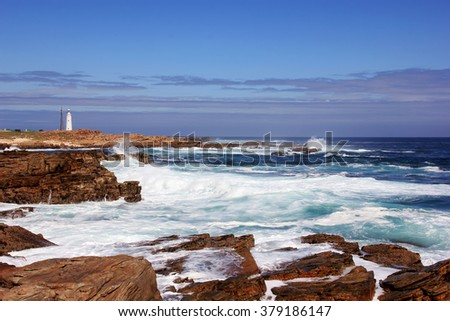 Beautiful colorful rocky coastline of South Africa, ocean view over rocks near Betty's Bay, outdoors - stock photo