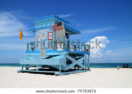 Beautiful colorful scene of a fancy lifeguard hut on North Miami Beach on a sunny day - stock photo