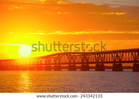 Beautiful colorful sunset or sunrise with broken bridge. Taken at Bahia Honda state park in the Florida Keys, near famous tourist destination of Key West.  - stock photo