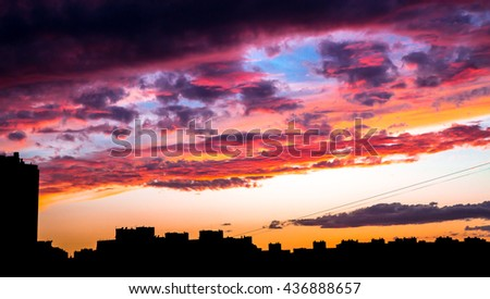 Beautiful colorful sunset under the city in the evening without any effects. Sky consist of many rainbow colors: red, orange, yellow, blue, violet. - stock photo