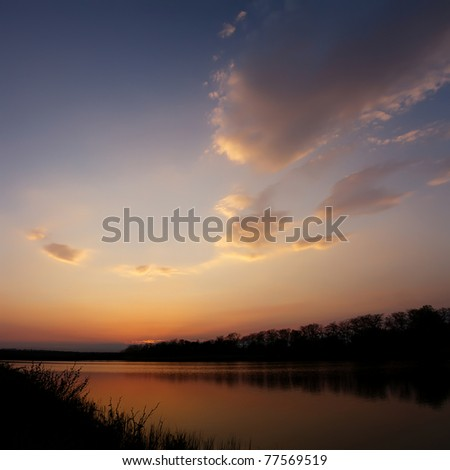 Beautiful colors of dusk in the warm summer evening - stock photo