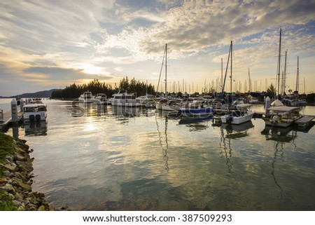 Beautiful composition view of Malaysian Harbour with a yatch during sunset.Vibrants colour - stock photo