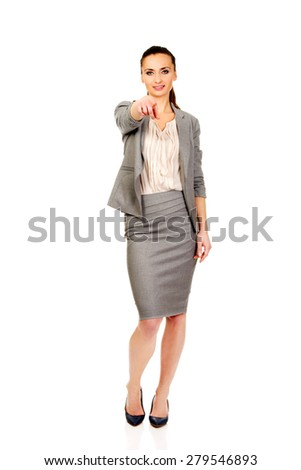 Beautiful confident businesswoman pointing on you. - stock photo