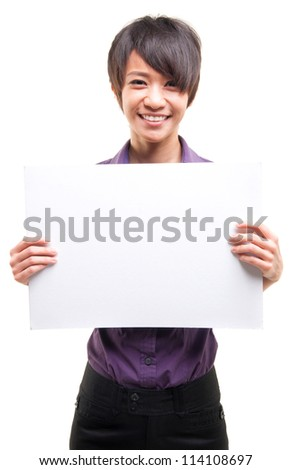 Beautiful cool Asian girl holding a white card board over white background - stock photo