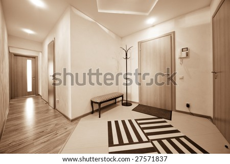 beautiful corridor with a door in a modern apartment - stock photo