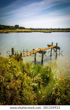 Beautiful countryside landscape with a lake and and small pier  - stock photo