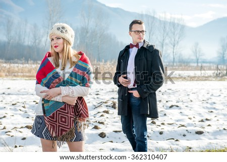 Beautiful couple enjoying the winter sun. They celebrate Valentine's Day. - stock photo
