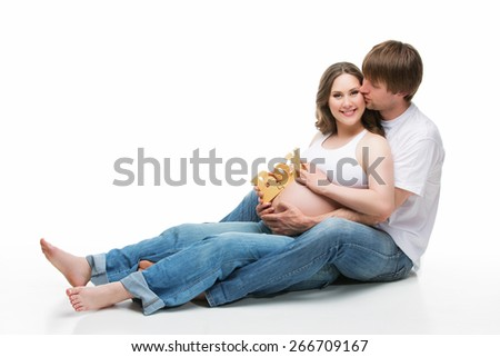 Beautiful couple expecting their first baby boy. Pregnant woman. Isolated over white background - stock photo