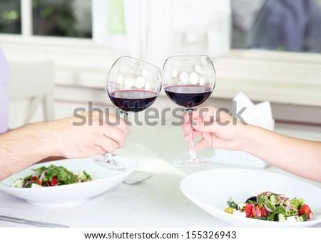 Beautiful couple having  romantic dinner at restaurant - stock photo