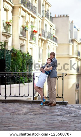 Beautiful couple hugging at Montmartre in Paris - stock photo
