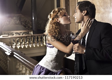 Beautiful couple in love having date in mysterious, historical residence - stock photo