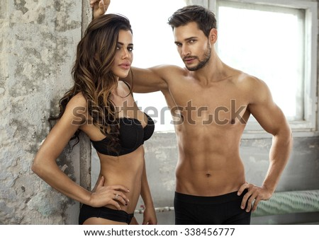 Beautiful couple in underwear - stock photo