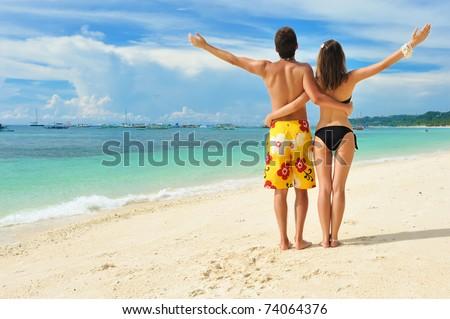 Beautiful couple on a tropical beach - stock photo
