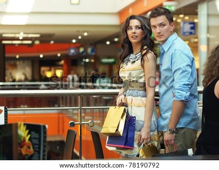 Beautiful couple on shopping trip - stock photo