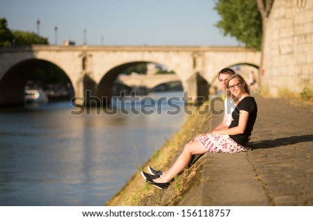 Beautiful couple on the Seine embankment - stock photo