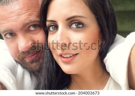 Beautiful Couple taking a selfie - stock photo