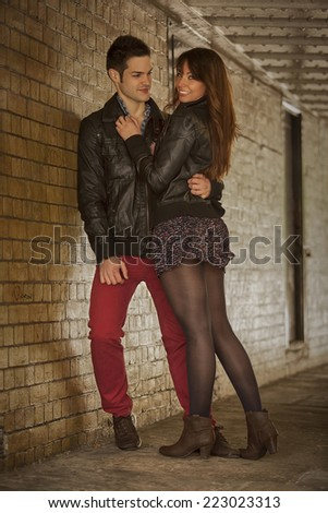 beautiful couple under bridge in London - stock photo