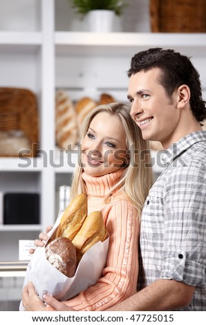 Beautiful couple with grain products on a forward background - stock photo