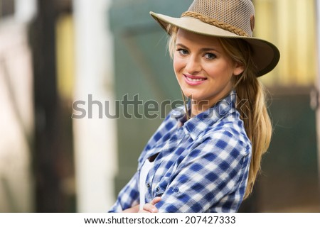 beautiful cowgirl close up portrait in stables - stock photo