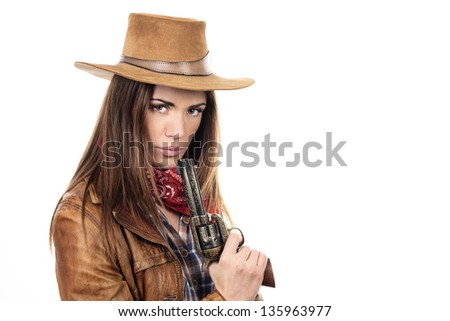 Beautiful cowgirl with gun on white background - stock photo