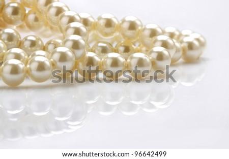 beautiful creamy necklace on white background - stock photo