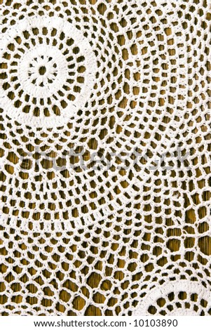 Beautiful crochet tablecloth for background. - stock photo