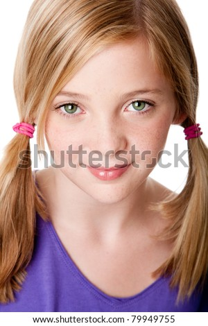 Beautiful cute sincere face of happy teenager girl with pigtails, blond hair, green eyes and freckles, isolated. - stock photo