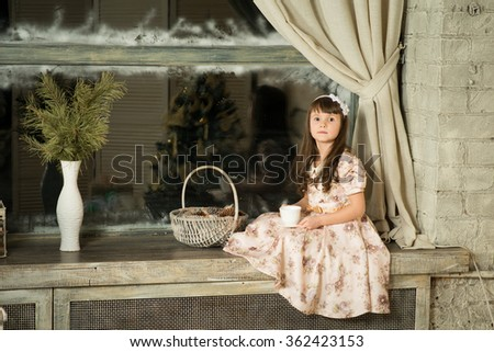 beautiful Cute smiling baby sitting at home by the window - stock photo